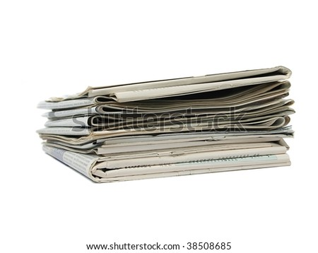 Pile of newspaper isolated on white background - stock photo