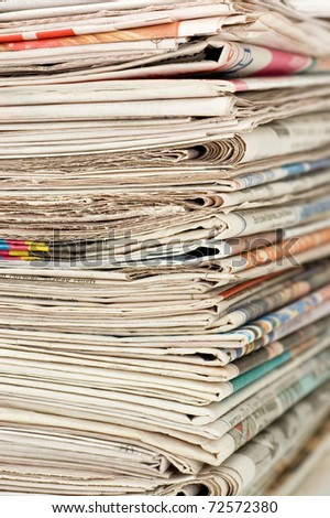 Pile of newspapers close up - stock photo