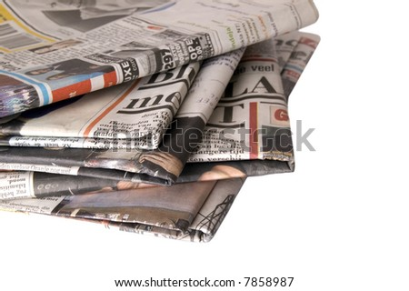 Pile of newspapers on a white background - stock photo