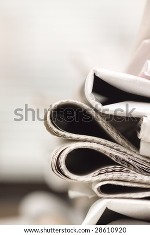 pile of newspapers on the table - stock photo