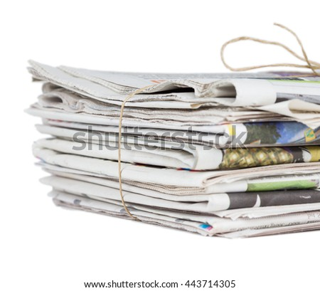 Pile of newspapers, tied with a string - stock photo
