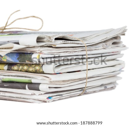 Pile of newspapers, tied with a string. Isolated on white background. Morning news, journalism, power of the media, newspaper and magazine subscription and ads concept. Large stack of newspapers. - stock photo