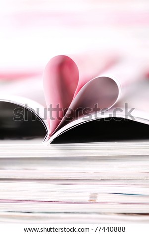 pile of newspapers with heart inside - relaxing time - stock photo