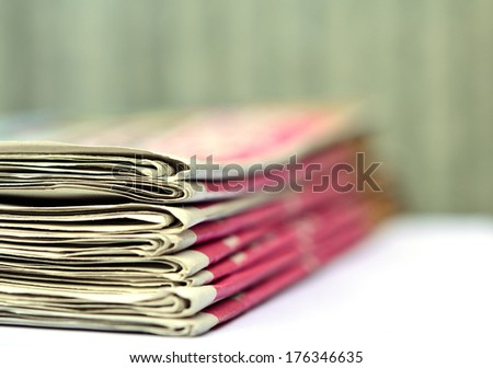 Pile of newspapers with space - stock photo