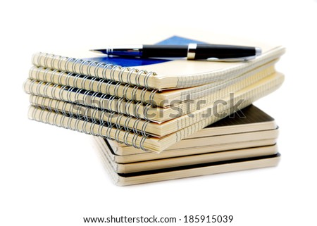 Pile of notebooks isolated on a white background - stock photo