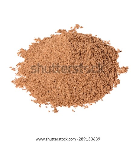 Pile of Nutmeg powder isolated on white background. Used as a spice in many sweet as well as savoury dishes and medicine. - stock photo