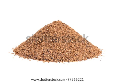 Pile of Nutmeg powder (Myristica fragrans) isolated on white background. Used as a spice in many sweet as well as savoury dishes and medicine. - stock photo
