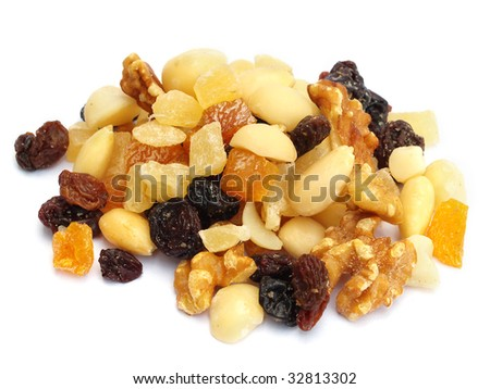 Pile of nuts and dried fruit isolated on white
