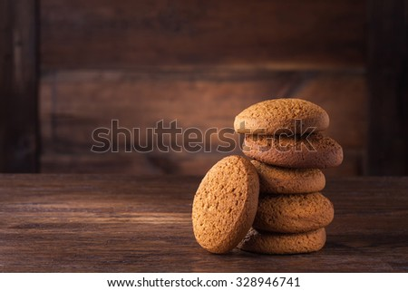 pile of oat cookies on wooden table