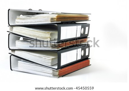 Pile of office ring binders with tax documents on white background - stock photo