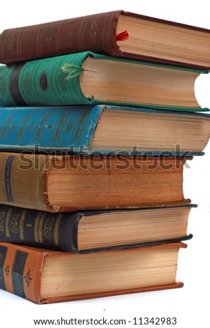 """Pile of Old Antique Books with label """"1"""" on white background - stock photo"""