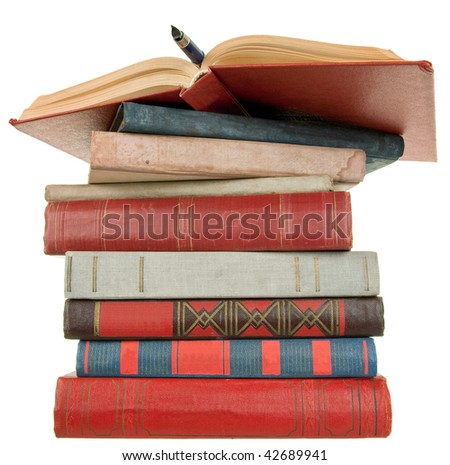 pile of old books and pen on white