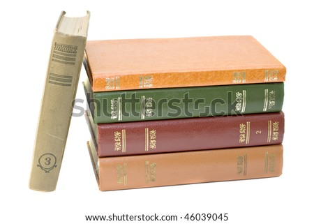 pile of old books isolated on a white background - stock photo