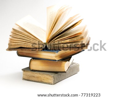 Pile of old books on the white background