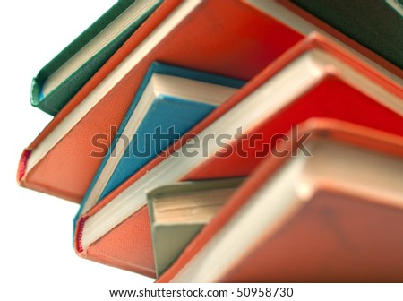 Pile of old books on white background. Isolated, shallow DOF - stock photo
