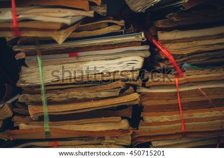 Pile of old books Stacked after moving. - stock photo
