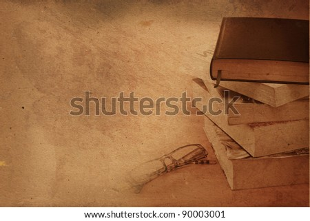 Pile of old books with reading glasses - stock photo