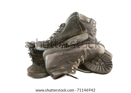 Pile of old boots isolated on white background - stock photo