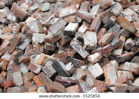 Pile of Old Bricks on a Construction Site - stock photo