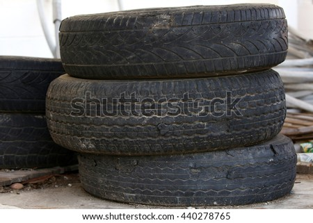 Pile of old car tires for rubber recycling