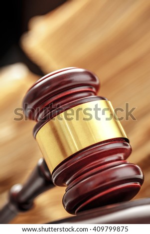 Pile of old cards with gavel in closeup - stock photo