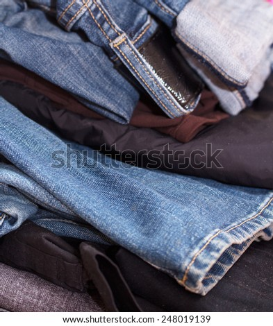 pile of old clothing items - stock photo