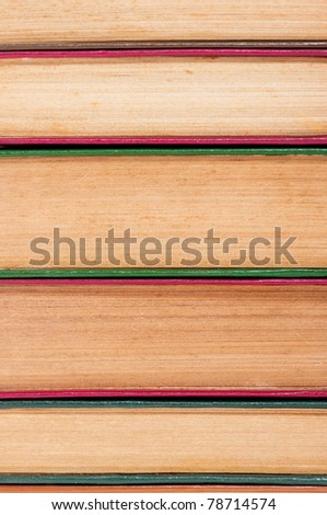 Pile of old dirty books on book shelf - stock photo