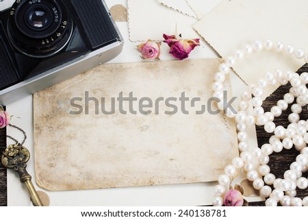 pile of old empty photos with frame of vintage cameras - stock photo