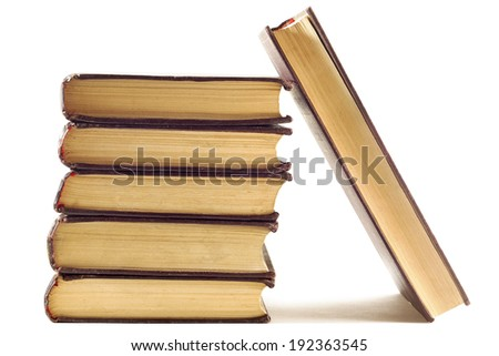 Pile of old leather bound books over white - stock photo