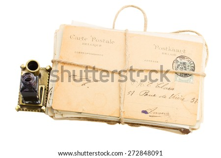 pile of old mail with inkwell   isolated on white background - stock photo