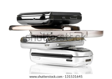 Pile of old mobile phones over a white background - stock photo
