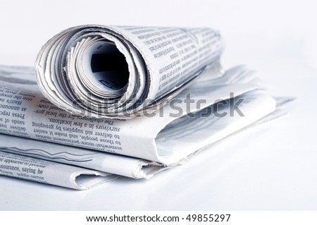 pile of old newspaper on a white background - stock photo