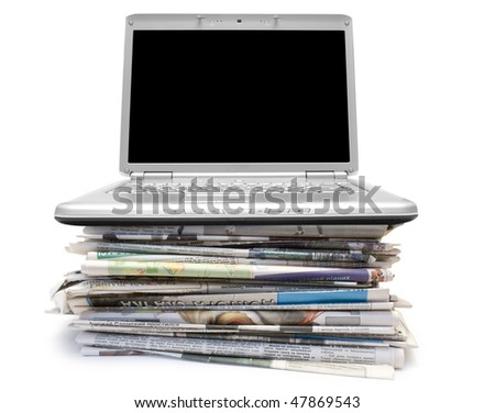Pile of old newspapers isolated on a white background