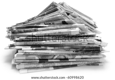 Pile of old newspapers isolated on a white background - stock photo