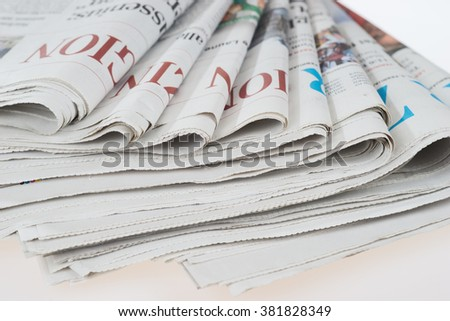 Pile of old newspapers, selective focus - stock photo