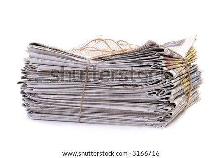 Pile of old newspapers tied with string over white - stock photo