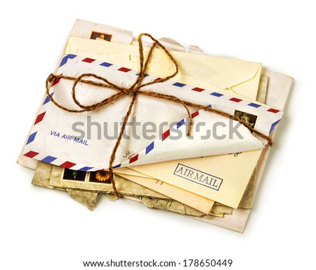 Pile of old overseas air mail letters tied with a thread - stock photo