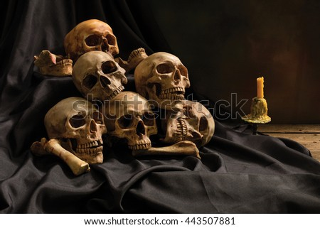 Pile of old skull on black cloth background  / Still life style