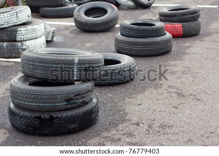 Pile of old tires and wheels for rubber. Closeup for design work - stock photo