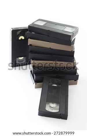 Pile of Old VHS Video Cassettes Isolated on a White Background. - stock photo