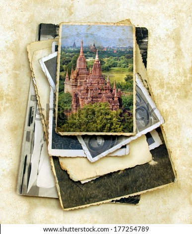 pile of old vintage photographs with on top a colorful image from the valley of Bagan in the asian country Myanmar,consisting thousands of ancient temples and pagodes, all UNESCO protected