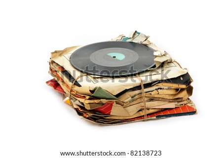Pile of old vinyl records isolated on white background - stock photo