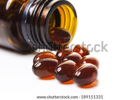 Pile of omega 3 fish oil capsules isolated on white background - stock photo
