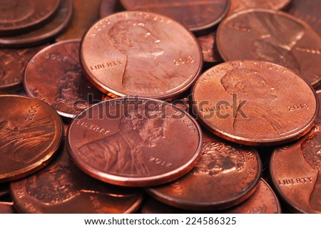pile of one cent coins isolated on white background - stock photo