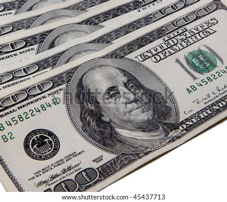 Pile of one hundred American dollars on white background