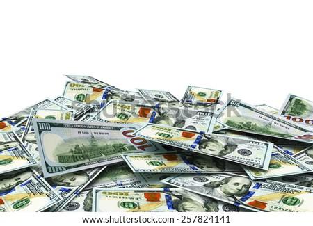 Pile of one hundred dollar bills isolated on white background - stock photo