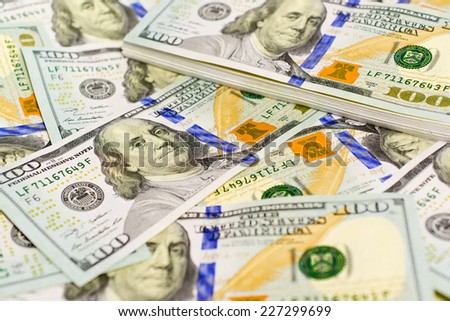Pile of One hundred US dollar bills as wealthy concept - stock photo