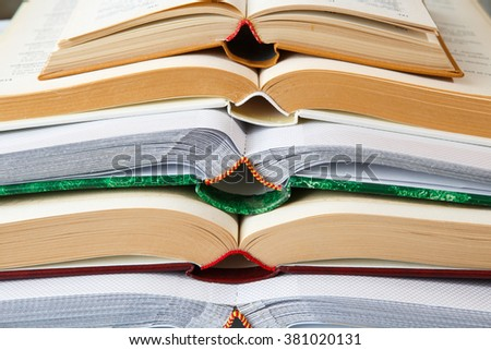 Pile of open books - stock photo