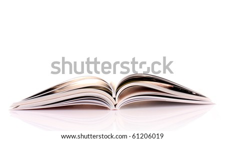 Pile of open magazines isolated on white background