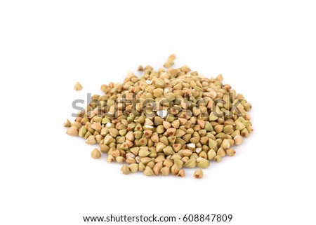 Pile of organic bio buckwheat raw on white background